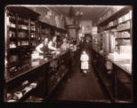 Workers and customers in an apothecary store
