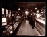 Workers and customers in a cigar shop/soda fountain
